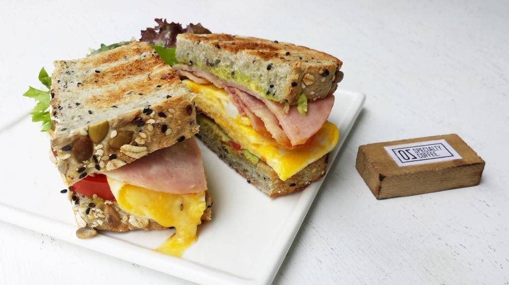 Signature Club Sandwich ($8.50)  Multi-grain toast, Avocado spread, Cold cut, Bacon, Tomatoes, Cheese Omelette