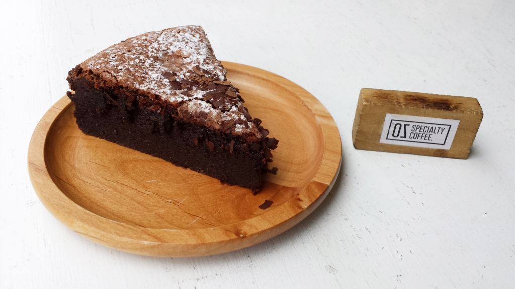 """Flourless Chocolate Cake  This cake, if I'm not mistaken, is actually from a nearby bakery called """"BerryGerryBakes"""". They are along situated in Thomson V Two & usually has cakes sold in OZ."""