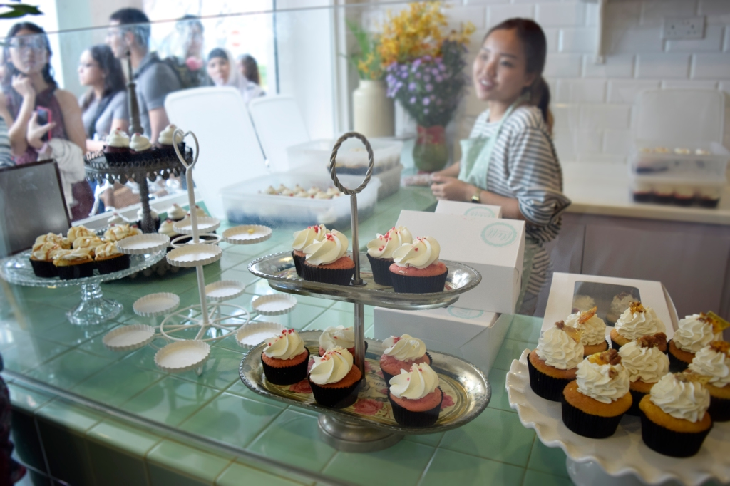 Cupcakes nicely showcased on their cupcake stands.