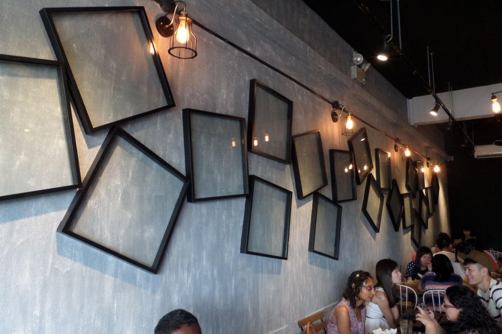 Wall decor of Lola's. Pretty neat, perhaps some photos of their food in the empty frames would add a nice touch?