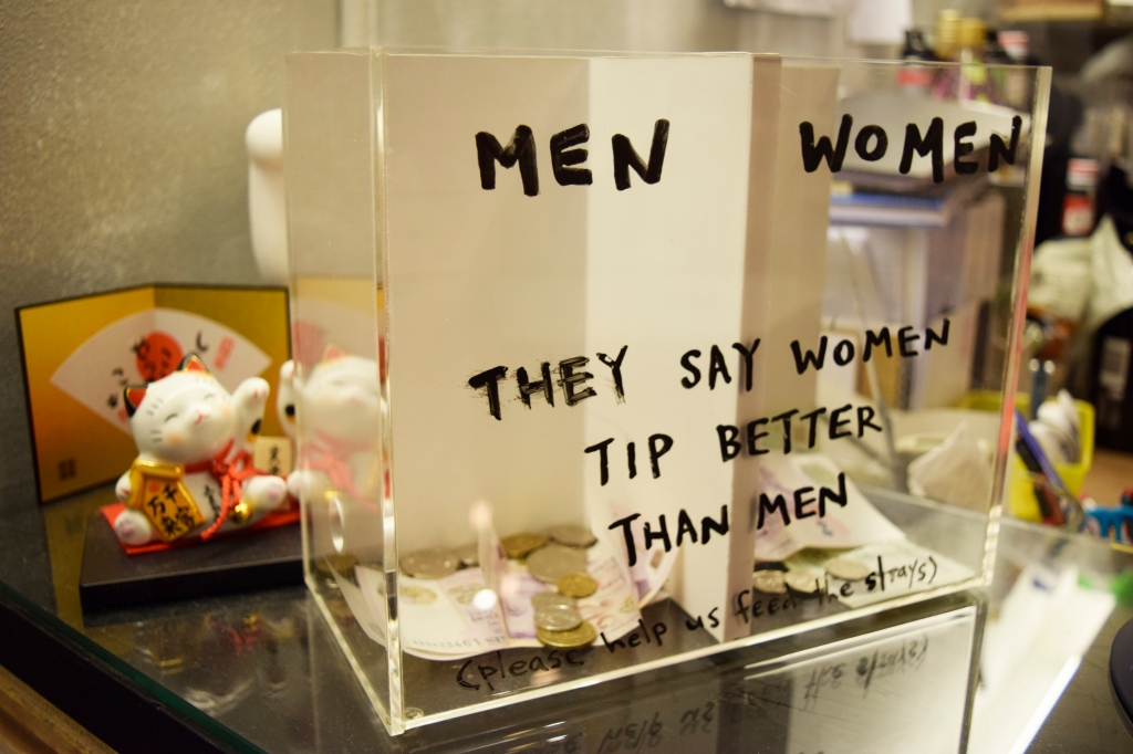 Came across this tip box. Who's winning? Come on, guys!