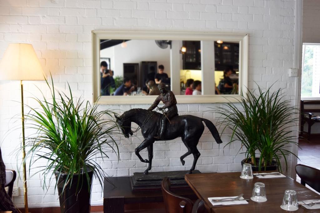 A horse & jockey statue.