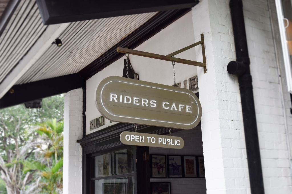 Hanging signage outside Riders.