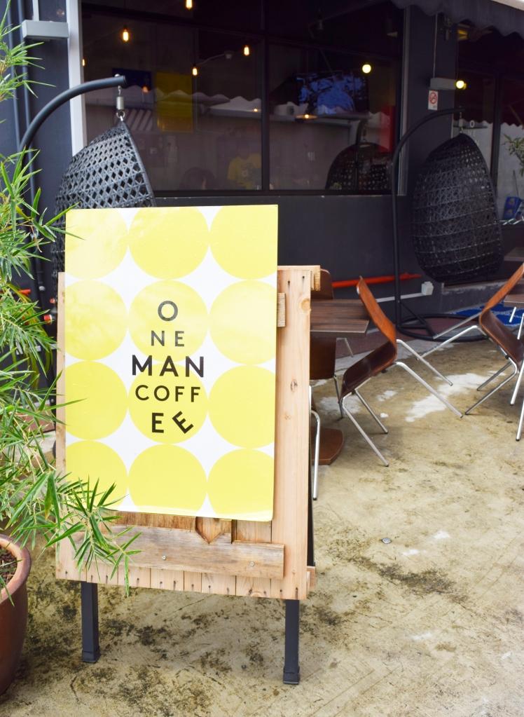 Signboard outside One Man Coffee.