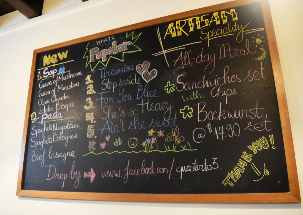 A large chalkboard on the wall with a list of their specialities.