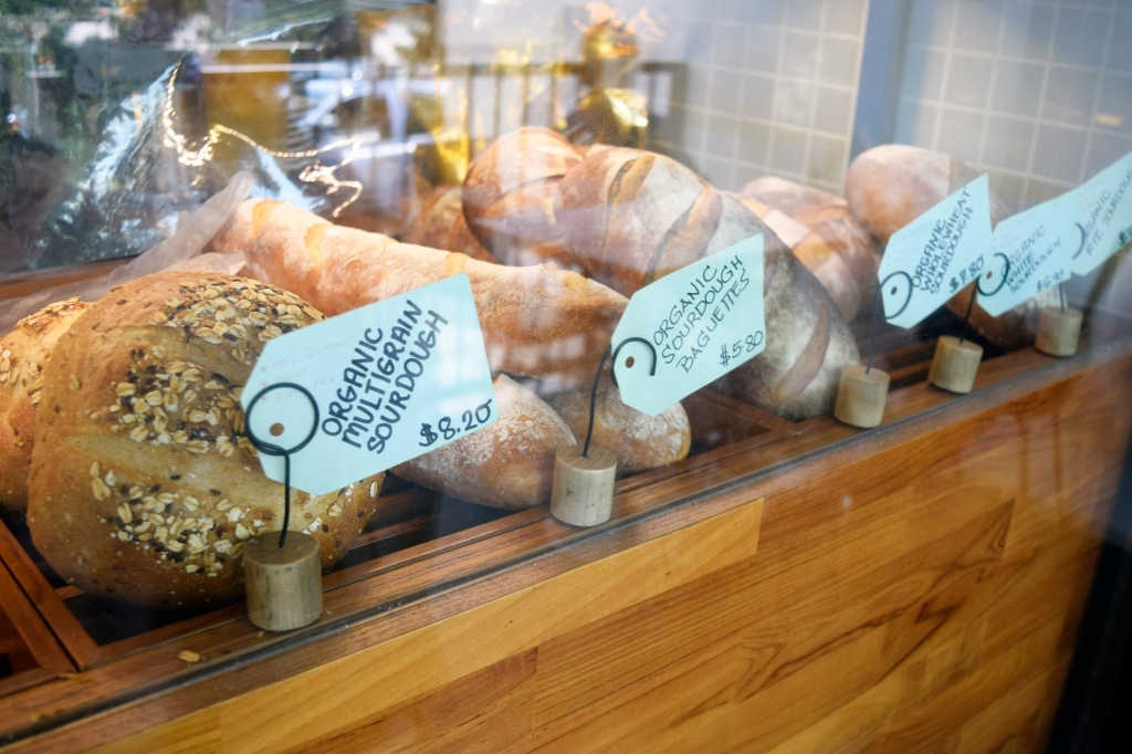 Organic whole breads on display.