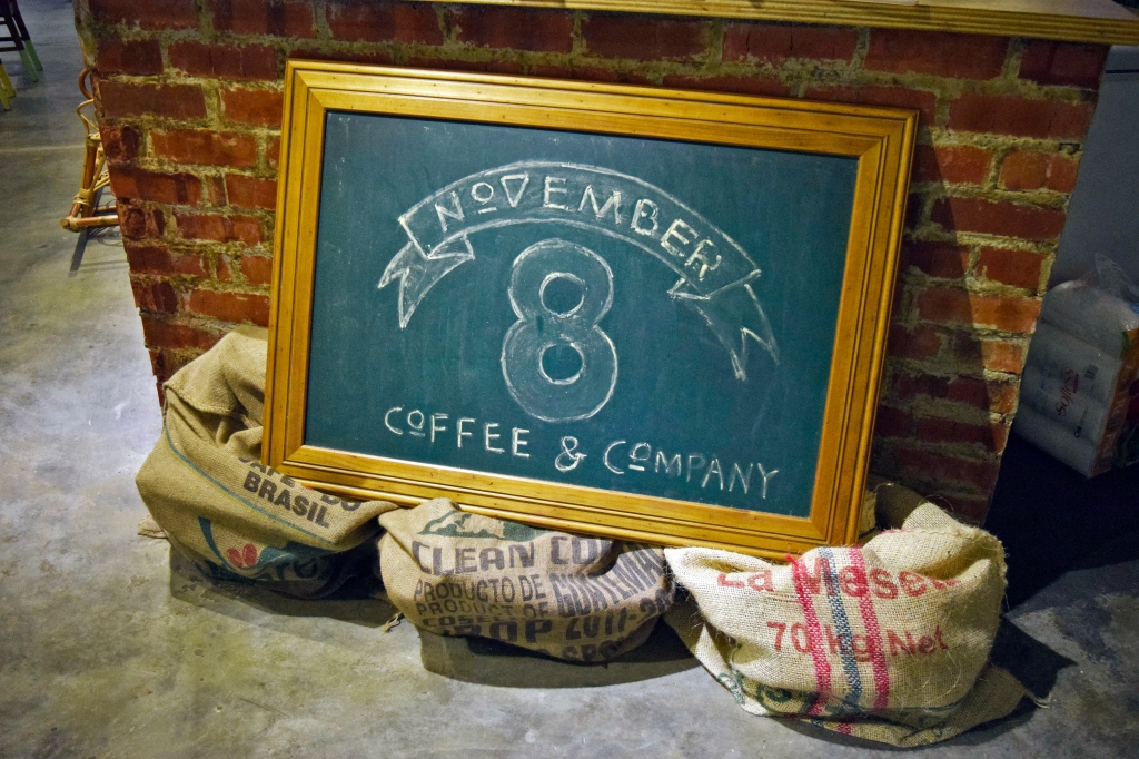 A chalkboard sign of their cafe greets you at the entrance.