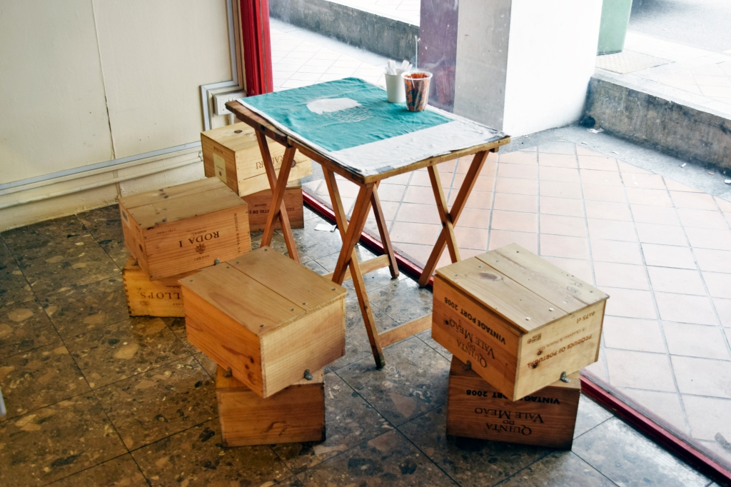 One of their eye-catching seating areas.  Crate boxes used as chairs. Anyone dare to sit here?
