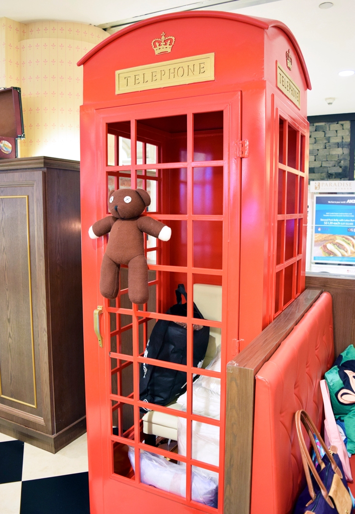 London's iconic red phone booth. (Unfortunately, it's occupied with junk.)