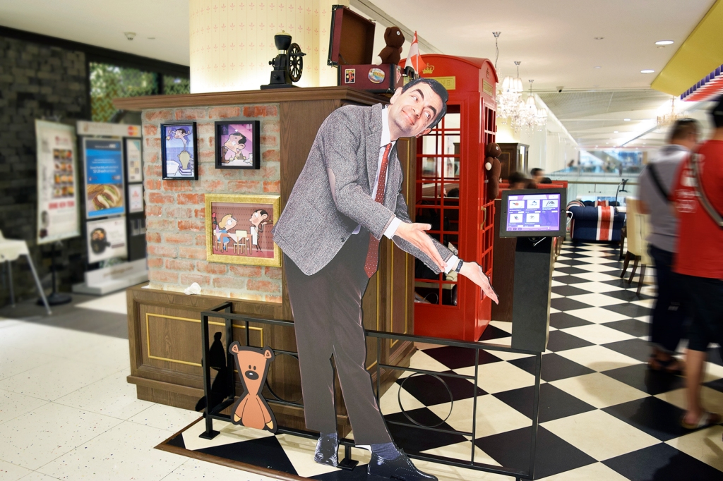 A life-size cut-out of Mr. Bean welcoming you into the cafe.