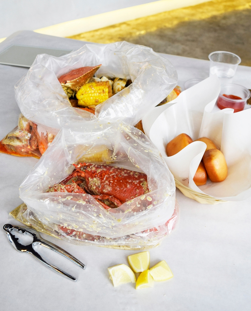 """The Bombdiggity Bag also comes with a basket of fried buns, as you can see here. Perfect companions to dip into the delicious sauces. You are also provided with lemon wedges to squeeze onto your seafood. """"The Works"""" The sauce - """"The Works"""", is basically comprised of various Cajun spices, somewhat  similar to the main sauce from The Cajun Kings. I do find that I prefer the sauce here than the one at The Cajun Kings. The sauce here is much more to my palette. Though I do find that the sauce from The Cajun Kings tastes more authentic with a stronger flavour of spices which takes some getting use to."""
