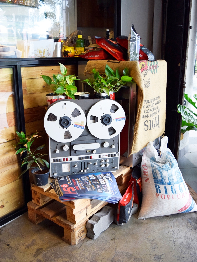 A pretty cool vintage tape recorder-turned planter outside the nook.