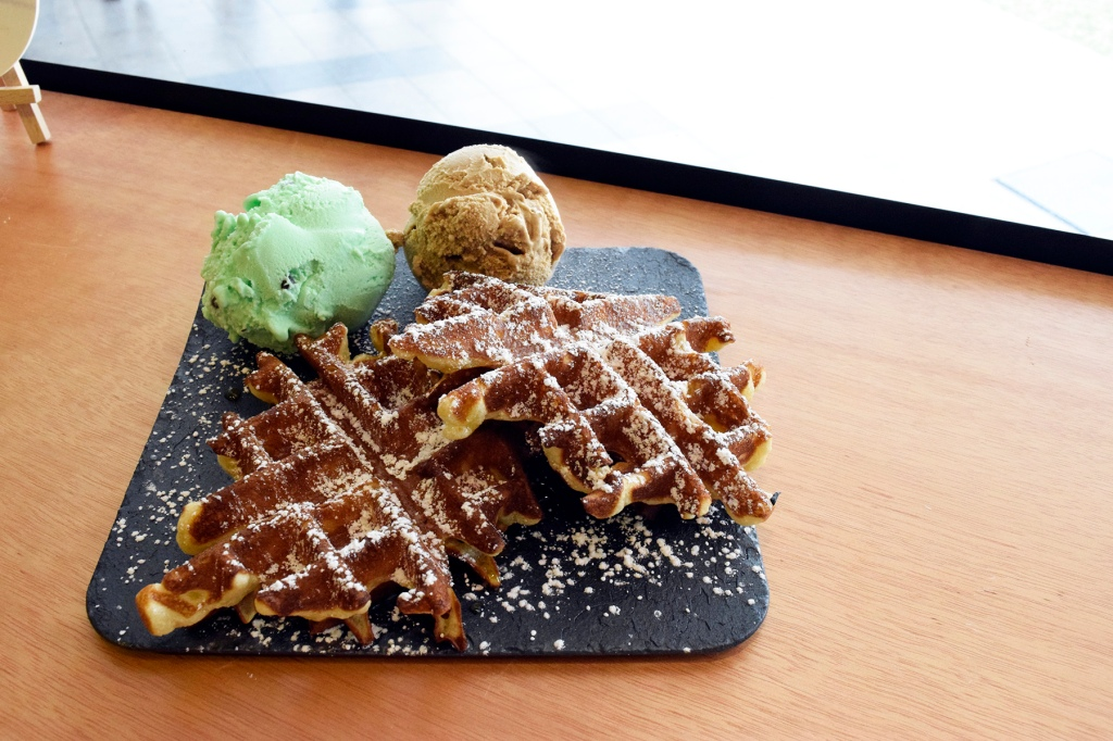 "Snowflake Waffles + Ice-Cream ($9.50 + additional $3 for another scoop) With Minty Chocolate & Sea Salt Caramel My friend had  this and he loved both choices of ice-cream as well. I managed to try the Sea Salt Caramel ice-cream & I agreed that it was delicious. (Though I'm at that point where anything caramel sickens me.) The waffles were really fantastic as the quantity was just nice, without pushing you overboard. The slight dusting of sugar was a perfect complement, bringing out the essence of ""Snowflakes""."