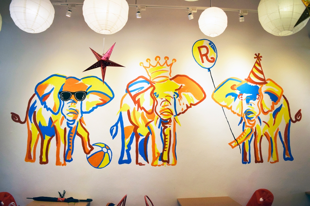 A pretty cool mural on the wall, featuring elephants, each representing the three owners/siblings of the place.