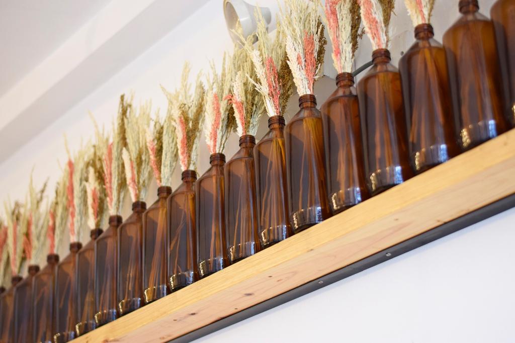 Amber bottles line the shelves.