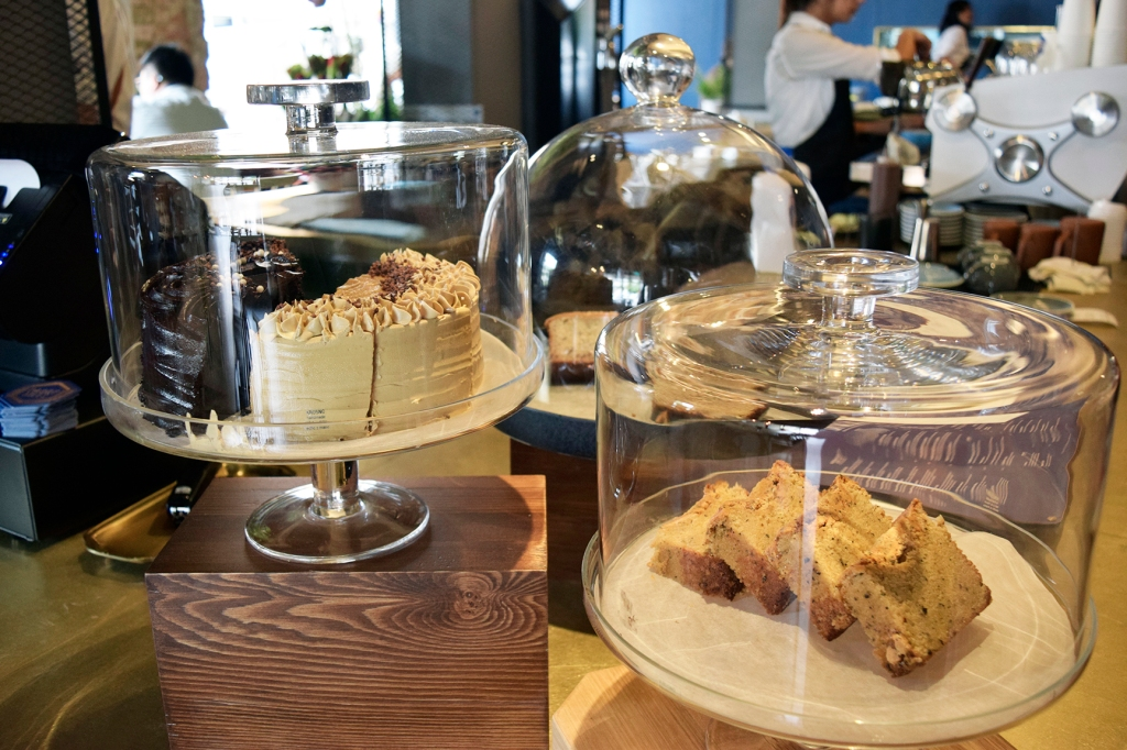 Some cakes & desserts on display at the counter.
