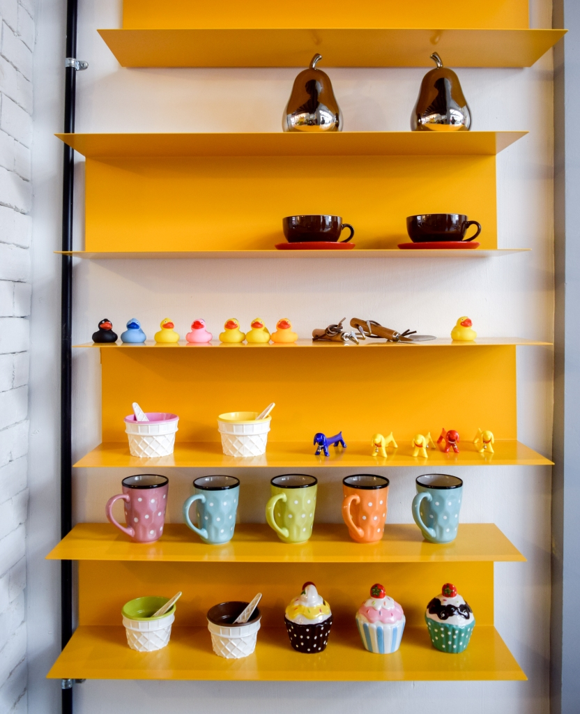 Yellow shelves with cute little decor.