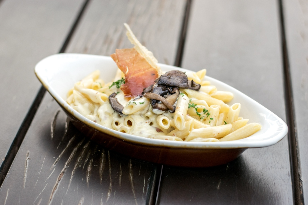 """Penne ($18) Carbonara, Crispy Prosciutto, Mushrooms I thought it was quaint how the pastas were listed by their pasta type. Carbonara. A staple in my diet, which was why it was a no-brainer to try the one here. The Carbonara tasted quite delicious. The cream was luscious & the dish was filled with bits of bacon. My friends commented that it didn't taste like the normal Carbonaras they had, but in a good way. I replied that it was probably because this was more of the authentic Italian cuisine flavour. The crispy Prosciutto was pretty much the """"Cherry on top""""."""